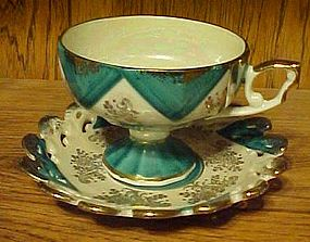 Fancy vintage cup and saucer articulated with lustre