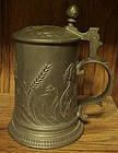 Pewter lidded stein art noveau raised floral design