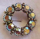Large vintage blue aurora borealis circle pin / brooch