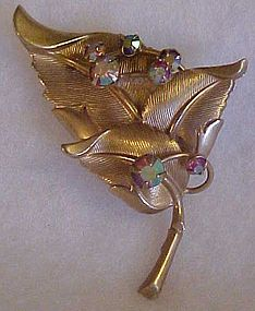 Vintage goldtone leaf pin with aurora rhinestones