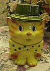 Vintage tabby cat cookie jar with polka dot tie and hat