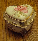 Vintage enamel heart music box with porcelain rose