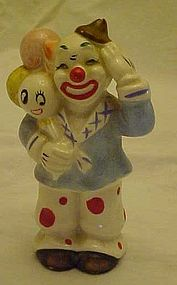 Vintage clown figurine with anthropomorphic balloons