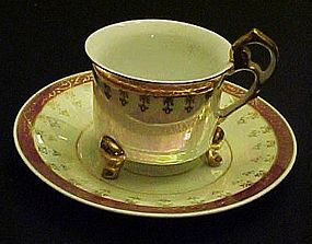 Fancy lustre three legged tea cup and saucer set