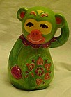 Groovy 70's green and orange ceramic monkey bank