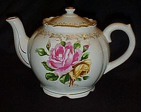 Lovely vintage porcelain teapot with pink yellow roses