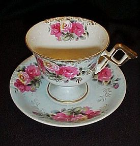 Vintage footed tea cup and saucer set Hand painted