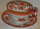 Antique Japanese tea cup and saucer with bird handle