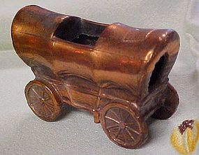 Old cast metal covered wagon ashtray toothpick?