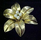 Vintage ART gold tone flower pin with pearls  center