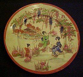 Old Geisha ware Geishas pointing  on bench  6 1/8 plate
