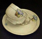 D&B Germany lustreware cup and saucer, flower basket