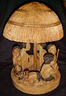 Hand carved Zimbabwe tribe and hut figure. Signed