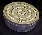 Vintage woven lidded basket with cowrie shells