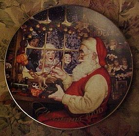 Avon Christmas 1996 plate Santa's Loving Touch