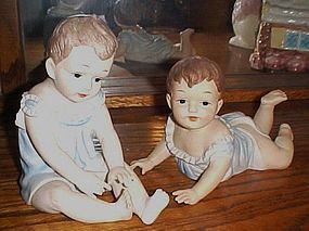 Large bisque Piano babies figurines pair