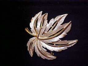 Beautiful vintage JJ goldtone and white maple leaf pin