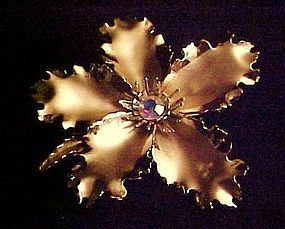 Vintage 1950's  gold tone flower pin rhinestone center