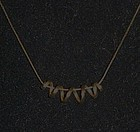 Napier dainty gold tone necklace with spring coil