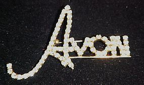 Avon word rhinestone represenative pin