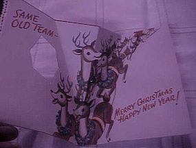 Vintage 50's pop up Christmas card with Santas reindeer