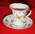 Fancy demitasse teacup and saucer with butterflies