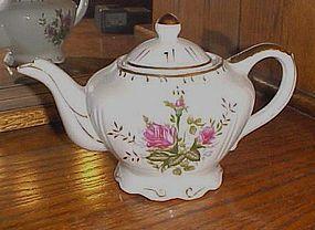Vintage porcelain Moss Rose musical teapot