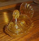 Vintage light amber glass turkey on nest covered dish