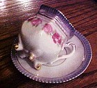 Antique Germany 4 leg teacup and saucer set with lustre trim and roses