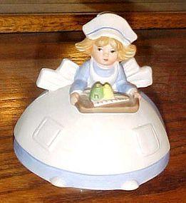 Musical porcelain nurse figurine plays you light up my life