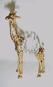 Brass giraffe with crystal prism belly