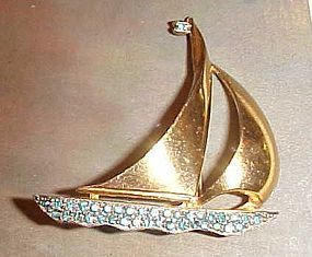 Vintage gold tone sailboat pin with rhinestones