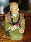 Vintage Hakata Urasaki old man with bottle figurine