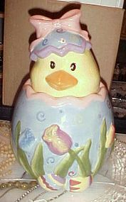 Easter egg cookie jar with hatching chick tulips and Easter eggs