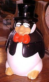 Vintage US sly penguin in top hat and tie cookie jar