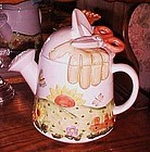 Large ceramic watering can and gardening themed cookie jar