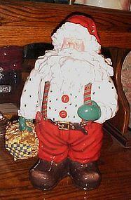 Santa Claus with basket of gingerbread men cookies, cookie jar