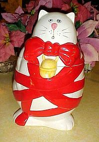 Christmas Kitty cat cookie jar wrapped in red ribbon and bow