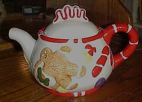 Gingerbread cookies and candy ceramic teapot