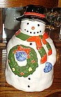 Festive Snowman holding wreath cookie jar