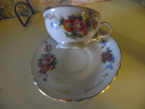 Vintage SGK  Occupied Japan floral  demi cup and saucer set