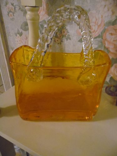 Hand blown glass orange purse vase