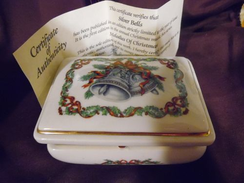 Heritage House Melodies of Christmas porcelain music box Silver Bells