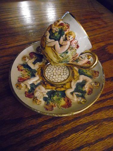 Vintage Capodimonte cherubs demitasse cup and saucer # 738