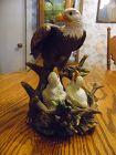 Large porcelain Eagle with eaglets in nest figurine