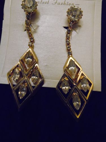Elegant gold tone rhinestone dangle runway clip earrings