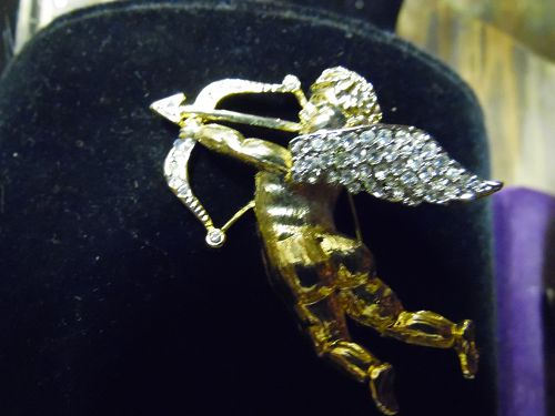Gold Tone Cupid pin with Rhinestone wings and bow