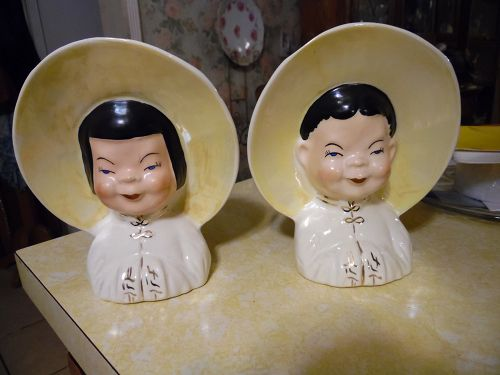 Vintage ceramic Asian boy and girl wall pockets