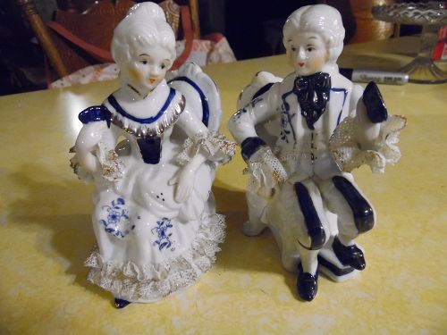 Victorian pair seated figurines cobalt blue and white net lace trim