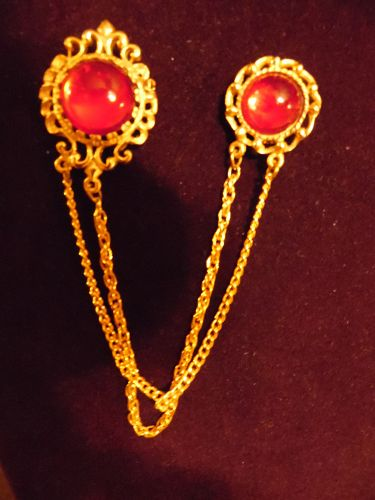Gold tone sweater guard pins with ruby red cabochons